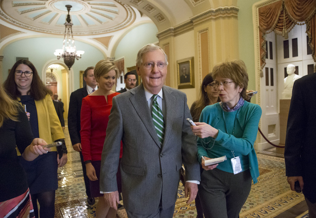Senate Majority Leader Mitch McConnell, R-Ky., walks to the chamber after President Barack Obama urged Senate Republicans to grant hearings and a confirmation vote to Merrick Garland, his nominee  ...