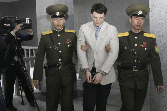 American student Otto Warmbier, center, is escorted at the Supreme Court in Pyongyang, North Korea, Wednesday, March 16, 2016. North Korea's highest court sentenced Warmbier, a 21-year-old Univers ...