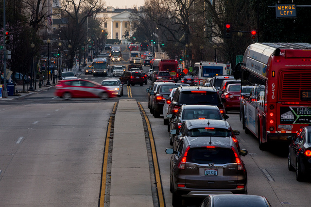 The White House is visible as morning traffic builds along 16th Street Northwest in Washington, Wednesday, March 16, 2016. The Metro subway system that serves the nation's capital and its Virginia ...