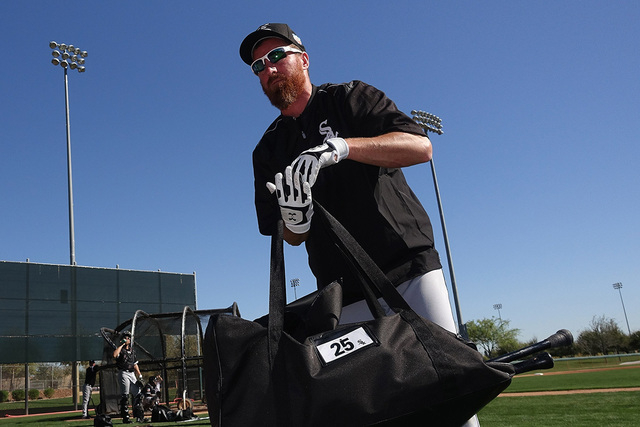 In this Feb. 26, 2016, file photo, Chicago White Sox's Adam LaRoche picks up his gear after taking live batting practice during a spring training baseball workout in Glendale, Ariz. (AP Photo/Ross ...