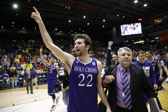 Holy Cross' Robert Champion (22) celebrates after the team's First Four game against Southern University in the NCAA college basketball tournament Wednesday, March 16, 2016, in Dayton, Ohio. Holy  ...