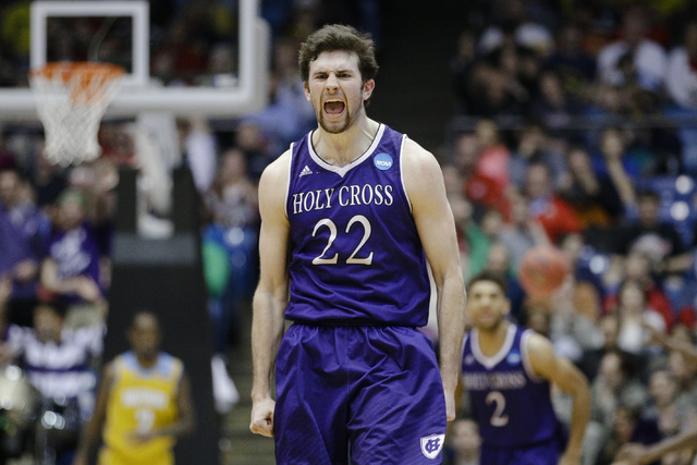 Holy Cross' Robert Champion reacts after hitting a 3-pointer during the second half against Southern University in a First Four game of the NCAA college basketball tournament, Wednesday, March 16, ...