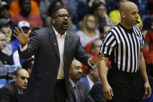 Tulsa coach Frank Haith gestures during the second half of the team's First Four game of the NCAA college basketball tournament against Michigan, Wednesday, March 16, 2016, in Dayton, Ohio. Michig ...