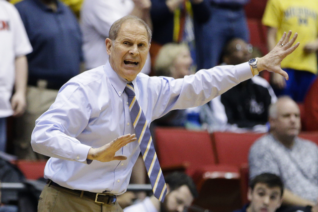 Michigan coach John Beilein gestures during the second half of the team's First Four game of the NCAA college basketball tournament against Tulsa, Wednesday, March 16, 2016, in Dayton, Ohio. Michi ...