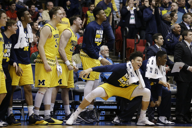 The Michigan bench clears after Moritz Wagner, not pictured, dunked during the second half of a First Four game of the NCAA college basketball tournament against Tulsa, Wednesday, March 16, 2016,  ...