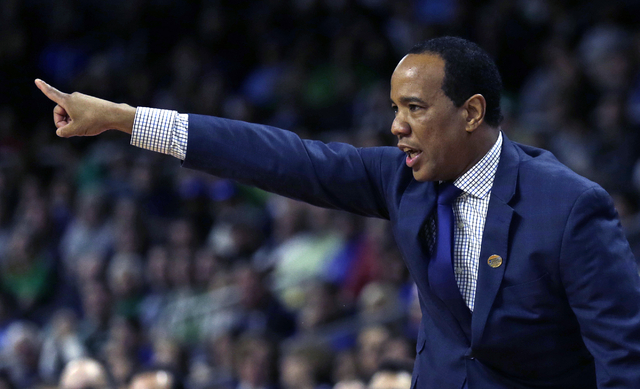 North Carolina-Wilmington head coach Kevin Keatts gestures against Duke in the first half iin the first round of the NCAA college men's basketball tournament in Providence, R.I., Thursday, March 1 ...