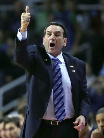 Duke head coach Mike Krzyzewski flashes a thumbs up against North Carolina-Wilmington in the first half during the first round of the NCAA college men's basketball tournament in Providence, R.I.,  ...