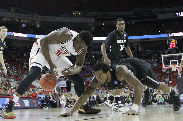 Butler forward Tyler Wideman (4) and Texas Tech center Norense Odiase (32) vie for a loose ball during a first-round men's college basketball game in the NCAA Tournament, Thursday, March 17, 2016, ...