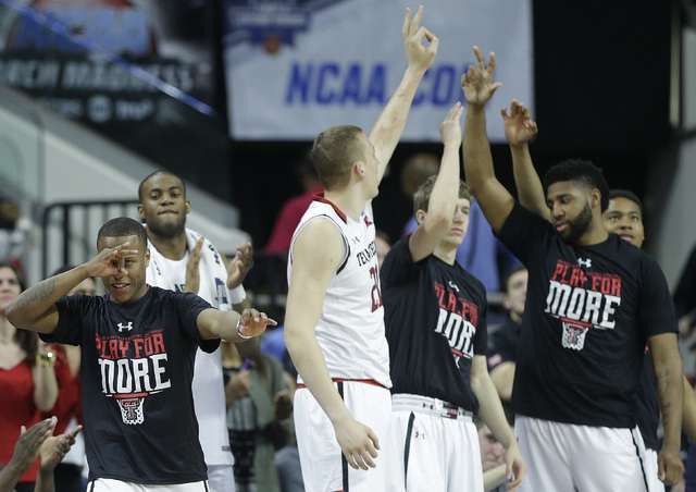 The Texas Tech bench cheers a three-point shot against Butler during the second half of a first-round men's college basketball game in the NCAA Tournament, Thursday, March 17, 2016, in Raleigh, N. ...