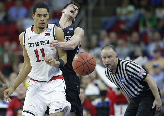 Texas Tech forward Zach Smith (11) and Butler guard Kellen Dunham (24) collide during the second half of a first-round men's college basketball game in the NCAA Tournament, Thursday, March 17, 201 ...