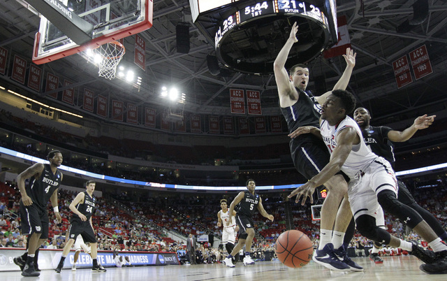 Texas Tech guard Keenan Evans (12) moves past Butler forward Andrew Chrabascz (45) during a first-round men's college basketball game in the NCAA Tournament, Thursday, March 17, 2016, in Raleigh,  ...