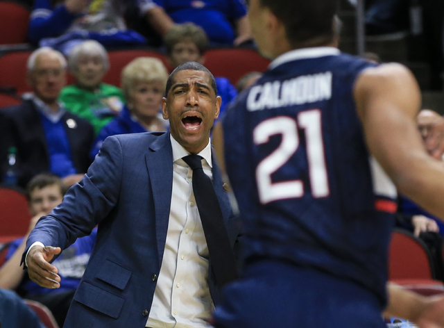 Connecticut coach Kevin Ollie shouts instructions during a first-round men's college basketball game against Colorado in the NCAA Tournament in Des Moines, Iowa, Thursday, March 17, 2016. (AP Phot ...
