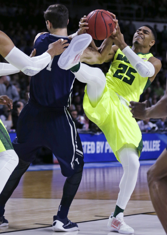 Baylor guard Al Freeman (25) battles for a rebound with Yale guard Anthony Dallier (1) in the first half during the first round of the NCAA college men's basketball tournament in Providence, R.I., ...