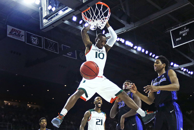Miami guard Sheldon McClellan (10) dunks against Buffalo during the first half of a first-round NCAA college men's basketball tournament game in Providence, R.I., Thursday, March 17, 2016. (AP Pho ...