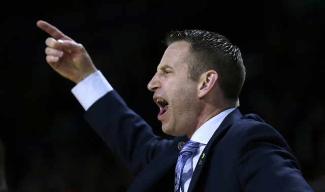 Buffalo coach Nate Oats calls to his players during the first half of a first-round game against Miami in the NCAA college men's basketball tournament in Providence, R.I., Thursday, March 17, 2016 ...