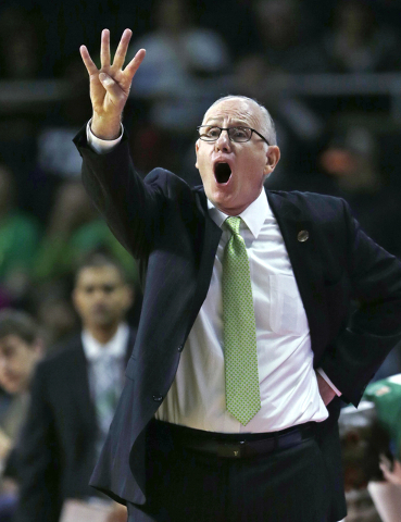 Miami coach Jim Larranaga calls to his players during the first half of a first-round game against Buffalo in the NCAA college men's basketball tournament in Providence, R.I., Thursday, March 17,  ...