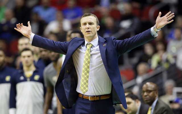 Chattanooga head coach Matt McCall reacts to a call during the first half of a first-round men's college basketball game against Indiana in the NCAA Tournament, Thursday, March 17, 2016, in Des Mo ...