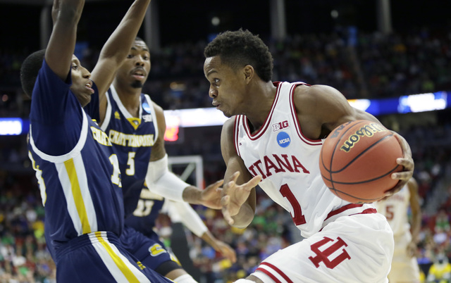 Indiana guard Yogi Ferrell drives to the basket during the second half of a first-round men's college basketball game against Chattanooga in the NCAA Tournament, Thursday, March 17, 2016, in Des M ...