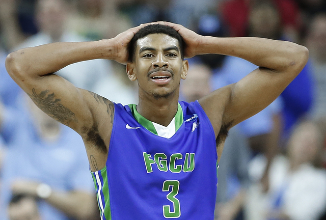 Florida Gulf Coast guard Julian DeBose (3) reacts to a penalty against North Carolina during the second half of a first-round men's college basketball game in the NCAA Tournament, Thursday, March  ...