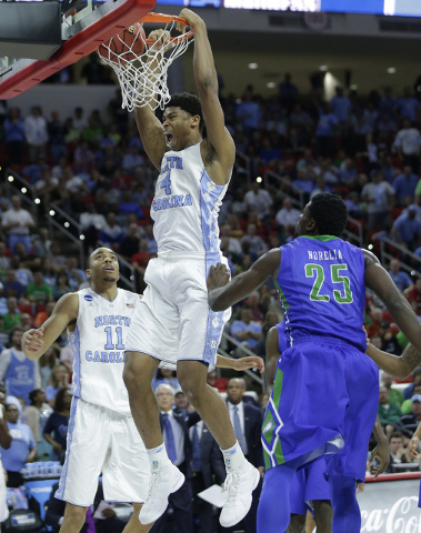 North Carolina forward Isaiah Hicks (4) dunks the ball by Florida Gulf Coast forward Marc Eddy Norelia (25) during the second half of a first-round men's college basketball game in the NCAA Tourna ...