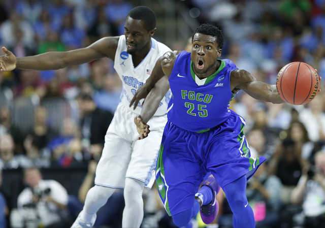 Florida Gulf Coast forward Marc Eddy Norelia (25) steals the ball from North Carolina forward Theo Pinson (1) during the second half of a first-round men's college basketball game in the NCAA Tour ...