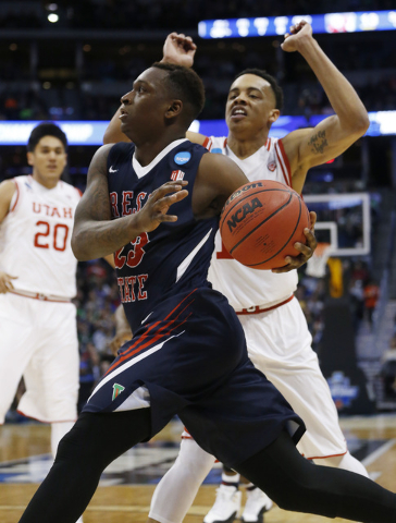 Fresno State guard Marvelle Harris, front, drives for a shot past Utah guard Lorenzo Bonam in the first half of a first-round men's college basketball game Thursday, March 17, 2016, in the NCAA To ...
