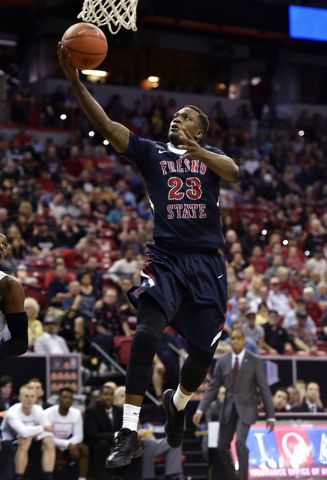FILE - In this March 12, 2016, file photo, Fresno State's Marvelle Harris shoots against San Diego State during the second half of an NCAA college basketball game in the final of the Mountain West ...