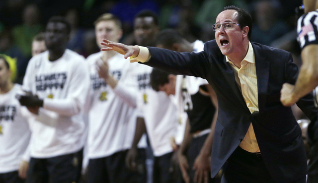 Wichita State coach Gregg Marshall calls to his players during the first half of an NCAA college basketball game against Arizona in the NCAA tournament in Providence, R.I., Thursday, March 17, 201 ...