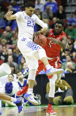 Kentucky guard Jamal Murray, left, steals the ball from Stony Brook guard Ahmad Walker during the first half of a first-round men's college basketball game in the NCAA Tournament, Thursday, March  ...