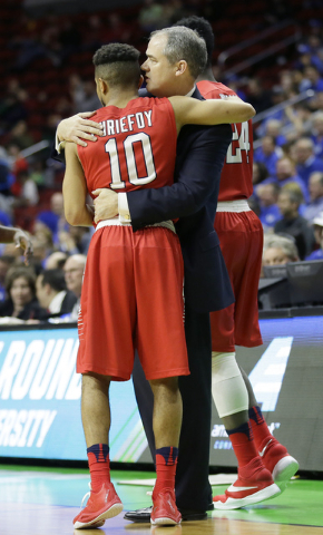 Stony Brook guard Carson Puriefoy (10) gets a hug from coach Steve Pikiell at the end of a first-round men's college basketball game against Kentucky in the NCAA Tournament, Thursday, March 17, 20 ...
