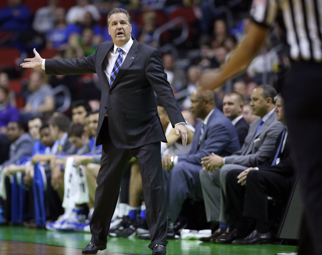 Kentucky coach John Calipari reacts to a call during the second half of the team's first-round men's college basketball game against Stony Brook in the NCAA Tournament, Thursday, March 17, 2016, i ...