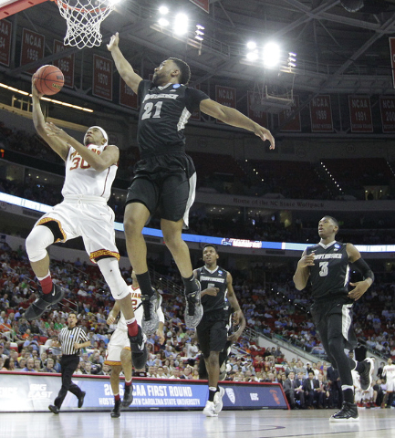 Southern California guard Elijah Stewart (30) shoots against Providence guard Jalen Lindsey (21) during the first half of a first-round men's college basketball game in the NCAA Tournament, Thursd ...