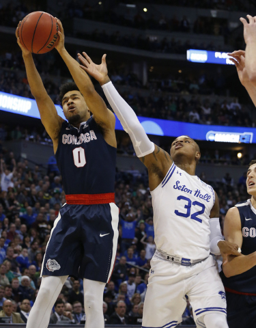 Gonzaga guard Silas Melson, left, pulls in a rebound as Seton Hall guard Derrick Gordon reaches for it during the first half of a first-round game Thursday, March 17, 2016, in the NCAA men's colle ...