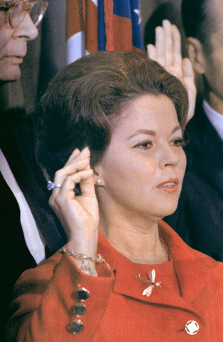 Shirley Temple Black raises her hand at the United Nations as she is sworn in as a U.N. delegate, Sept. 16, 1969. The child star-turned-ambassador was given the 9.54 carat blue diamond ring she is ...
