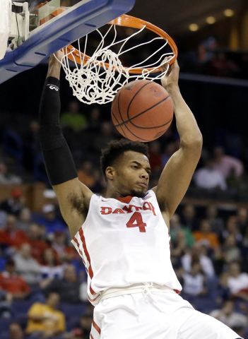 Dayton's Charles Cooke dunks the ball during the first half against Syracuse in a first-round men's college basketball game in the NCAA tournament, Friday, March 18, 2016, in St. Louis. (AP Photo/ ...
