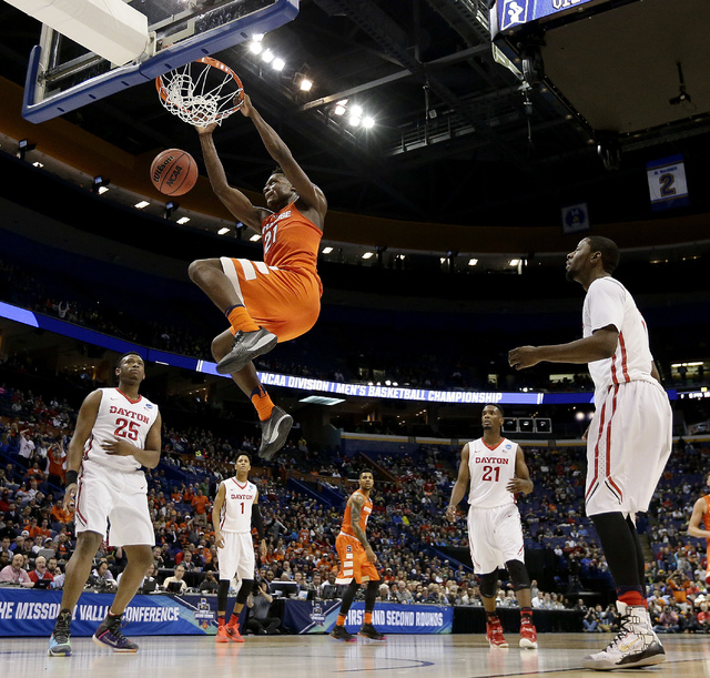 Syracuse's Tyler Roberson dunks the ball during the first half of a first-round men's college basketball game against Dayton in the NCAA Tournament, Friday, March 18, 2016, in St. Louis. (AP Photo ...