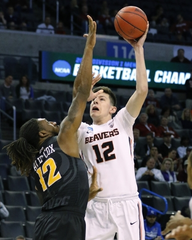 Oregon State forward Drew Eubanks (12) shots over Virginia Commonwealth forward Mo Alie-Cox (12) in the first half of a first-round men's college basketball game in the NCAA Tournament, Friday, Ma ...