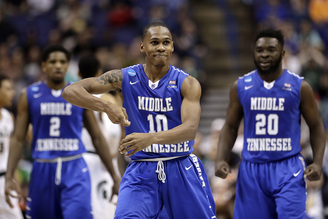 Middle Tennessee's Jaqawn Raymond (10) celebrates after making a basket during the first half of a first-round men's college basketball game against Michigan State in the NCAA Tournament, Friday,  ...