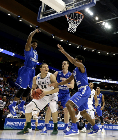 Michigan State's Gavin Schilling (34) is pressured by a group of Middle Tennessee defenders during the first half of a first-round men's college basketball game in the NCAA Tournament, Friday, Mar ...