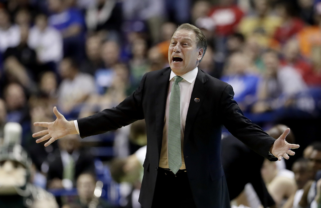 Michigan State head coach Tom Izzo talks to his players during the first half of a first-round men's college basketball game against Middle Tennessee in the NCAA Tournament, Friday, March 18, 2016 ...