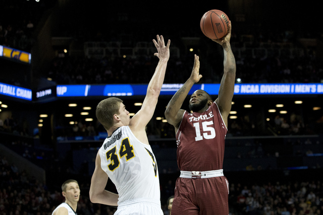 Temple forward Jaylen Bond (15) goes to the basket against Iowa center Adam Woodbury (34) during the first half of a first round men's college basketball game in the NCAA Tournament, Friday, March ...