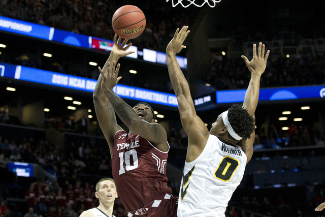 Temple forward Mark Williams (10) goes to the basket against Iowa forward Ahmad Wagner (0) during the first half of a first round men's college basketball game in the NCAA Tournament, Friday, Marc ...