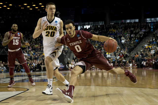 Temple forward Obi Enechionyia (0) drives to the basket against Iowa forward Jarrod Uthoff (20) during the first half of a first round men's college basketball game in the NCAA Tournament, Friday, ...