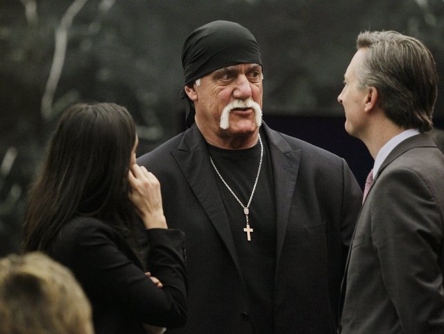 Hulk Hogan talks with his attorneys before the start of his trial Thursday, March 17, 2016, in St. Petersburg, Fla. Hogan, whose given name is Terry Bollea, and his attorneys are suing Gawker Medi ...