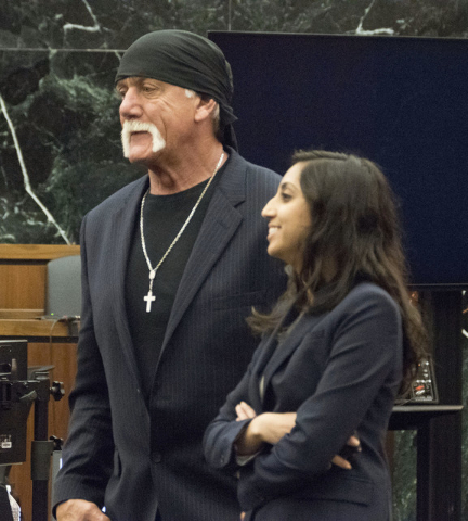 Former professional wrestler Hulk Hogan, left, along with attorney Seema Ghatnekar prepare to take a break just after the jury was handed Hogan's case against Gawker Media for deliberations on Fri ...