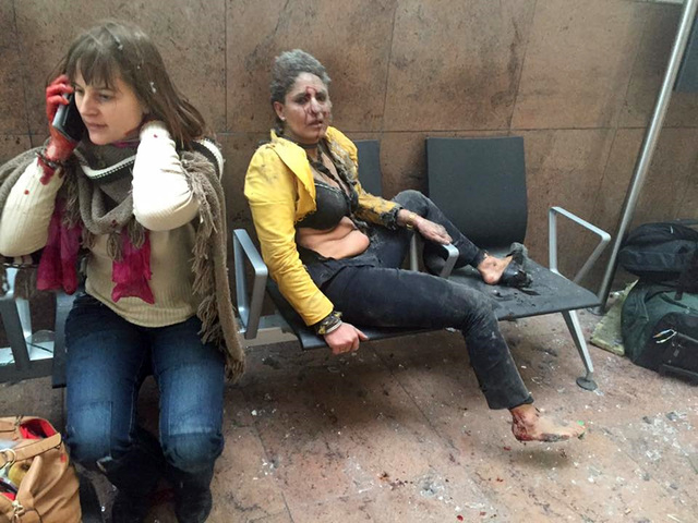 Two women wounded in Brussels Airport in Brussels, Belgium, after explosions were heard Tuesday, March 22, 2016. All flights were canceled, arriving planes were being diverted and Belgium's terror ...