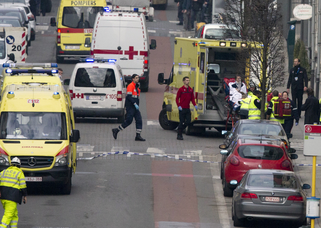 A woman is evacuated in an ambulance by emergency services after a explosion in a main metro station in Brussels on Tuesday, March 22, 2016. Explosions rocked the Brussels airport and the subway s ...