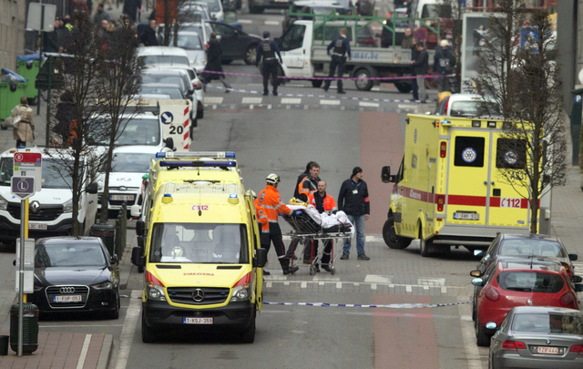 A victim is evacuated on a stretcher by emergency services after a explosion in a main metro station in Brussels on Tuesday, March 22, 2016. Explosions rocked the Brussels airport and the subway s ...