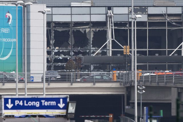 The blown out windows of Zaventem airport are seen after a deadly attack in Brussels, Belgium, Tuesday, March 22, 2016. Authorities in Europe have tightened security at airports, on subways, at th ...