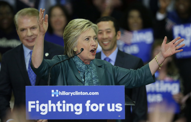 Democratic presidential candidate Hillary Clinton, center, speaks as Seattle Mayor Ed Murray, left, and his husband, Michael Shiosaki, right, look on Tuesday, March 22, 2016, during a campaign ral ...